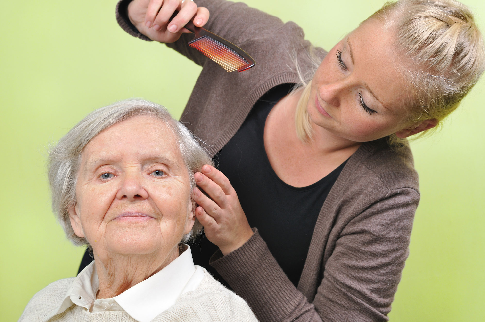 Senior-woman-with-her-caregiver-in-home.